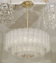 Substantial Doria Three Tier Chandelier with Brass Accents  $3,150