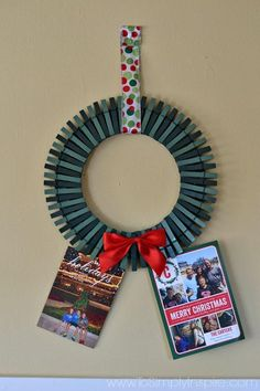 This DIY wreath is made of clothespins so you can display all of your Christmas cards! #diy #wreath #diywreath #clothespins #Christmascards #cardholderwreath #cardholder #Christmascardholder #diycardholder