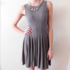 """HP! Theory Pleated Jersey Dress Excellent condition! Great olive color with form-fitting bodice and flattering pleats. The model in this photo is 5'9"""". Size small, could also accommodate an XS. This dress is sold out everywhere, therefore I won't entertain lowball offers! Smoke/pet free home. Ask all questions before buying  NO trades ❌ Bundle for a discount  Theory Dresses"""