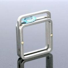 Angela Fung...the square shape of the ring, compliments the square faceted gemstone and creates a nice tension both in the design and the function.