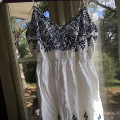 White and blue spaghetti strap dress size XS Really cute white dress with dark/navy blue embroidery at the top in the front and the bottom all the way around. Tight under bust to give a shape, adjustable spaghetti straps. Mossimo Supply Co Dresses Midi