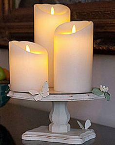 Luminara 4inch (10cm) diameter set of 3 Ivory flameless candles on a candle holder