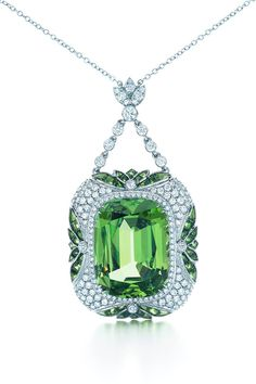 A cushion-cut tsavorite of 20.03 carats is framed in a softly contoured setting with an Art Deco motif of crisp leaves on a diamond and platinum chain. TIFFANY