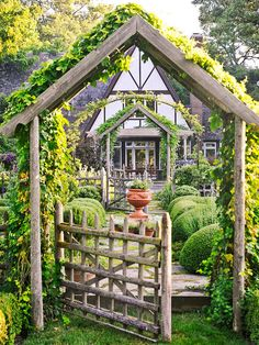 This arbor looks simple but I really like that it's not flat across the top like most  arbors and it follows the roof line of the home.