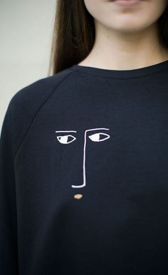 Abstract face print sweater
