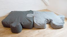Puzzle piece pillows. They would be great in a play room someday!