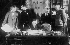 FIRST WORLD WAR 1914 - 1918 EASTERN FRONT (Q 45331) Herr von Kuhlmann signing the Treaty of Brest Litovsk which took Russia out of the First World War. Leon Trotsky, the Bolshevik Commissar for Foreign Affairs, and Count Czernin look on.