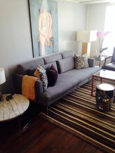 I needed some pattern in my living room, so the rug and the throw pillows were thrown into the mix. #B&BItalia sofa #EQ3 rug #facestool #CB2 table