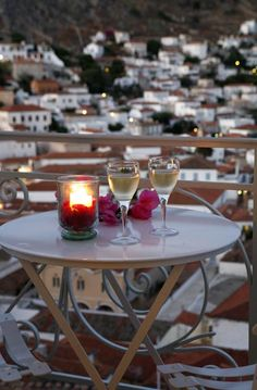 a glass of wine at the balcony, after a long day at the beach...Hydra island, Greece