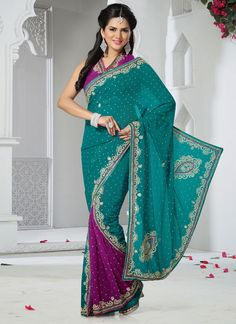Opulent teal and pink faux georgette designer saree is designed with embroidered, moti, stone, cut dana, diamond, resham, lace and shimmer patch border work. This saree comes with matching blouse. (Sl...