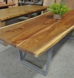 Solid Walnut live edge table on 3″ x 1″ steel legs <br /><span style='font-size:12px !important;'>Table dimensions: 97″ x 35″ average by 30″ high. Price $2775.00</span>