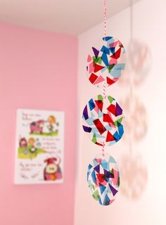 Pasándolo Pipa tissue paper and clear plastic mobile via The Crafty Crow