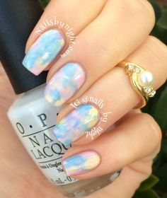 Pastel opal nails Transparent white polish > pastel dabs > smush with plastic > another coat of transparent white polish.