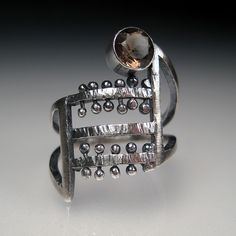 Ring | Sara Westermark.  Sterling silver and topaz.
