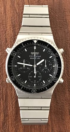 Up for sale is a gorgeous Seiko quartz chronograph Sports This watch is reminiscent of the classic Omega Speedmaster Professional. Men's Watches, Watches For Men, Speedmaster Professional, Omega Speedmaster, Omega Watch, Quartz, Sports, Fashion Design, Boots
