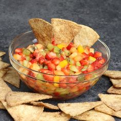 Quick and easy Fruit Salsa with Cinnamon Chips – delicious fruit salsa with crispy and sweet cinnamon chips. It comes together in no time. It's a great way to start the day, enjoy the day, or finish the day with this fresh Fruit Salsa! All you need is a few simple ingredients: Flour Tortillas, butter, cinnamon, sugar, pineapple, strawberries, kiwi, mango and lemon. Video recipe. | izzycooking.com