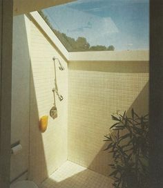 House unknown. Shower under skylight, square tiles, double showerhead. The Bed and Bath Book, by Terence Conran ©1978