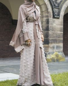 Lined with a gorgeous pink chiffon layer so can easily be worn open or closed. Layer a slip Abaya or minimalist outfit underneath, completing the look with matching shoes.