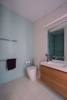 Light blue and white subway tiles cover the walls in this modern bathroom.