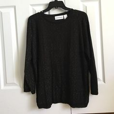 Black sweater with gold engraved throughout NEVER WORN! Great condition! Very soft! Light weight sweater! Gold string like material engraved throughout the sweater. Alfred Dunner Sweaters Crew & Scoop Necks