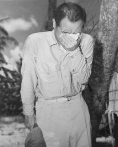 A Japanese POW breaking down into tears on Guam after hearing the radio announcement of the unconditional surrender of the Empire, 2 September 1945.