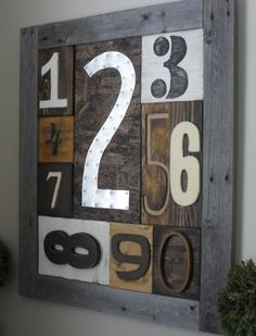 Home Frosting: Rustic Number Sampler - LOVE this!  So unique and creative!  It looks super expensive, but she created it for FREE using scrap lumber and metal.