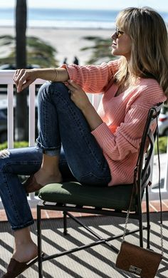 coral chunky knit v-neck sweater, ripped straight leg boyfriend jeans, brown leather slides and shoulder bag