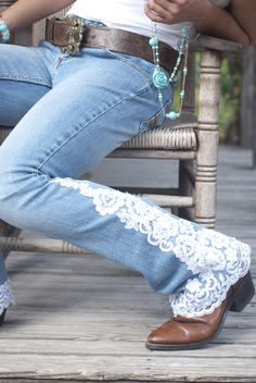 Oyster colored lace, with beads and sequins,  trim the hem and outer leg of a great fitting jean.  The lace applique is higher on one side than the other.  Rear pockets have lace trim.  All jeans are low to mid rise and boot cut.  www.shiftjeans.com Sizes 2-16 Denims and laces will vary.