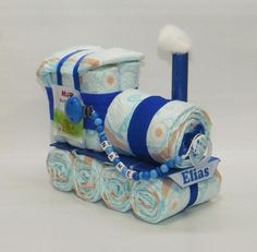 Diaper cake diaper locomotive + Pacifier Blue - Diaper cake diaper locomotive + pacifier chain blue Welcome to Windeltorte.bayern The diaper locomo - Diy Diapers, Baby Shower Diapers, Baby Shower Cakes, Baby Boy Shower, Baby Shower Gifts For Boys, Baby Party, Baby Shower Parties, Tea Party, Nappy Cakes
