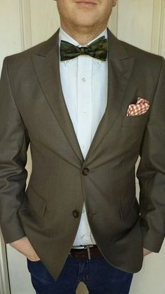Suit jacket on sale from JCP $20.00 Camo Bow tie: sale.at JCP $2.98 Orange/white.checkered Pocket square: sale for $2.98
