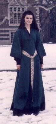 Ca. 12th century. 'It consists of a black long-sleeved undergown and a green linen overgown, with grey trim and a black wool border at the hem (to keep out the snow!). The sleeves are bell-shaped and the back laces up from tailbone to nape of neck - after the Norman Invasion of 1066, shapeless English tunics began to be replaced by newer French styles, which were fitted to the body with lacing and shaped seams.'