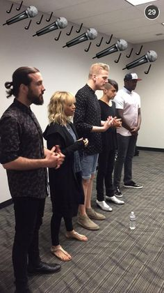 Scott is the only one wearing shorts, Kristie isn't wearing heels, there is a random water bottle in front of them, and look at Mitch's shoes!
