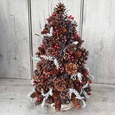 Pinecone and Berry Christmas tree topiary centerpiece. Rose hips and Statice on Birch log. Christmas Tree Topiary, Christmas Tree Crafts, Rustic Christmas, Christmas Tree Decorations, Holiday Crafts, Christmas Holidays, Christmas Ornaments, Xmas, Topiary Centerpieces