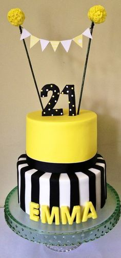 Cute cake with all yellow cake and bottom half stripes. Cute with a fondant red boxing glove on top instead of the pennant banner.