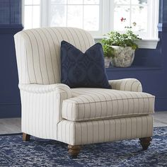 Essex Accent Chair by Bassett Furniture. Featuring a sectioned tight back with low arms that include a soft saddle shape.