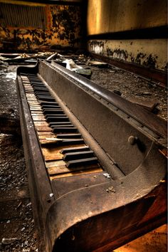 """*whistles*  Wow.  This fine lady would need plenty of tender, loving care.  You know, I'm a """"never say die"""" piano technician, but this might be a job even I would walk away from..."""