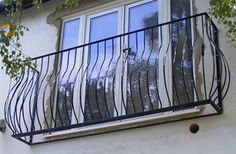 I like the curve in this metal juliette balcony