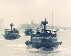 A floltilla of US Navy Patrol Boats (PBR) fires into enemy positions on Tan Dinh during operation Bold Dragon III during the Vietnam conflict, circa 1968. - See more at: http://photos.usni.org/content/3278429jpg#sthash.fWxiww4W.dpuf