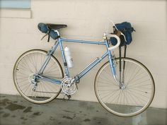 My 1977 S10-S with it's basic day touring set up. The original Cannondale handlebar bag which holds my wallet, cell phone, extra tube and tire tools, camera and big enough to stow a rain jacket and...