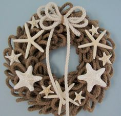 Beach decor nautical roping rope wreath with starfish. Nautical decor coastal wreath with real nautical rope and lots of white starfish, $79, BUY HERE: https://www.etsy.com/listing/207903477/beach-decor-starfish-wreath-nautical?ref=shop_home_active_11