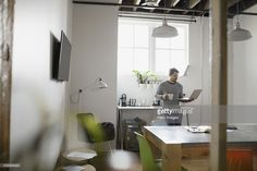 Stock Photo : Businessman with coffee using laptop in office