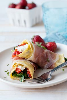 Prosciutto Wrapped Omelets With Spinach, Roasted Red Pepper + Goat Cheese.
