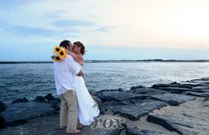 Sunset beach wedding on the rock jetty at the Ocean City Maryland Inlet:  https://www.roxbeachweddings.com/