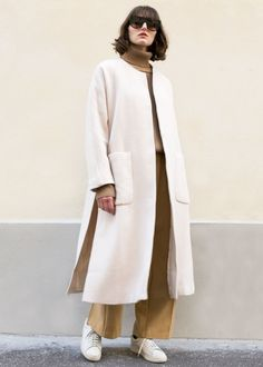"""Textured Light Coat w/High Side Slits & 2 Front Patch Pockets 3/4"""" Sleeves, Snap Button Closure. Fully Lined 100% Wool Lining - 100% Polyester 44"""" Length, 45"""" Bust Dry Clean Imported"""