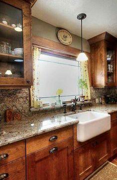 Farmhouse sink, dark rich cabinets, earth tones, hardware
