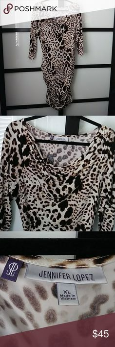 Sexy print plus size body con dress! This material is so luxurious and stretchy! The rouching is very flattering. Had drape neck. Used once Jennifer Lopez Dresses Midi