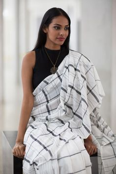 This Black & White checks handwoven saree with modern stripes will add a twist to your day to day saree look. Drape it loose or with neat pleats, it will be Trendy Sarees, Stylish Sarees, Simple Sarees, Saree Blouse Neck Designs, Saree Blouse Patterns, Ethnic Fashion, Indian Fashion, Black And White Saree, Phulkari Saree