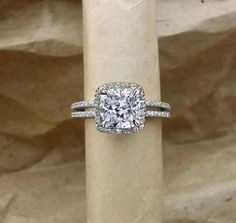 BEAUTIFUL HAND MADE ENGAGEMENT RING. Prices include ring and stone together. CENTER GEM: 1.75 carat 8mm cushion cut forever brilliant