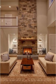 niches around fireplace and floor to ceiling stone
