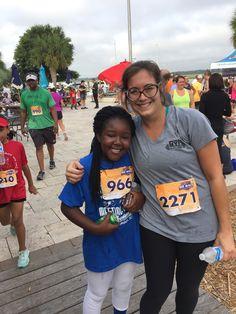 Meeting Street Academy Charleston scholar with her racing buddy at the Bohicket 5K! #MeetingStreetAcademy #MeetingStreetSchools #BenNavarro